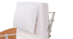 fitted sheets on bed with attached pillow
