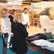 demonstrating adjustable beds at the OT Show