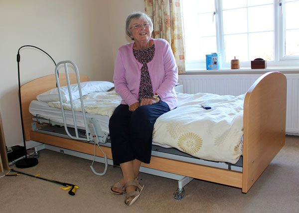 Old lady sat on electric bed