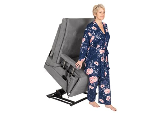 woman getting up from adjustable reclining grey chair