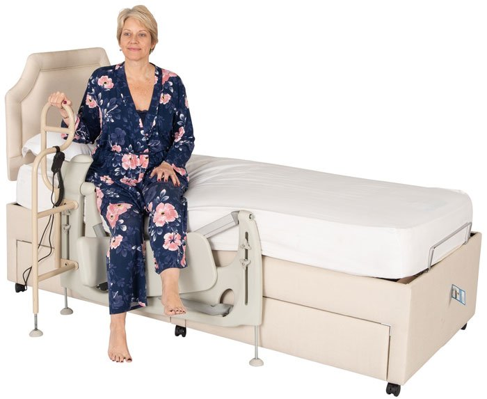 woman sitting on side of adjustable bed