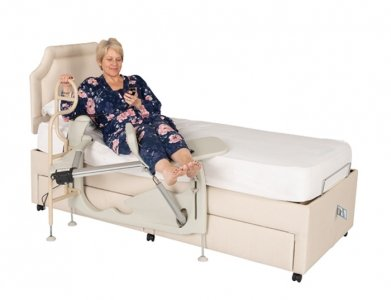 woman using machine to lift legs into bed