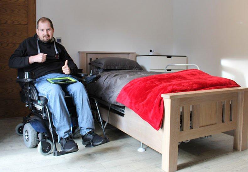 Jon Beck next to bed