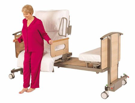 woman sat in a Rotoflex 235 Mk2 low access adjustable bed