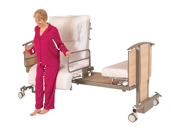 woman in adjustable bed with handrails