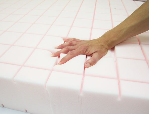 Hand pushing down on Memory Foam
