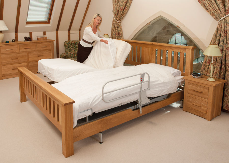 Woman putting sheet on adjustable bed