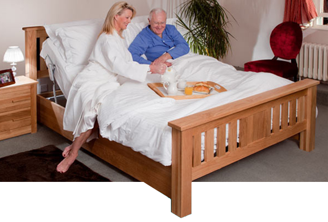 Couple sharing an adjustable bed