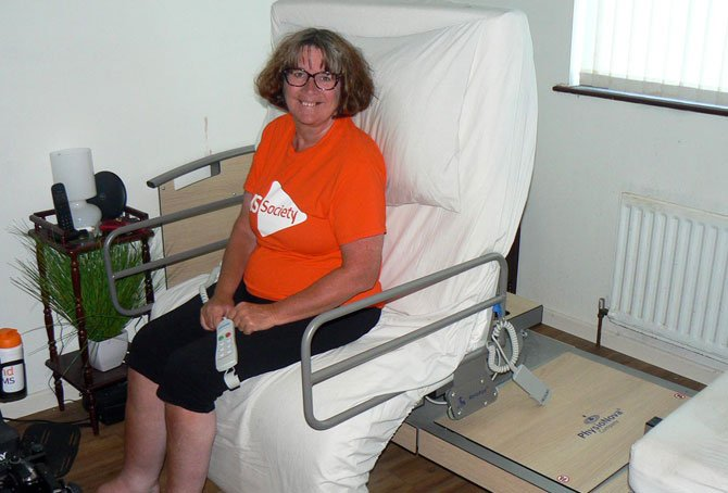 Woman sat on rotating bed